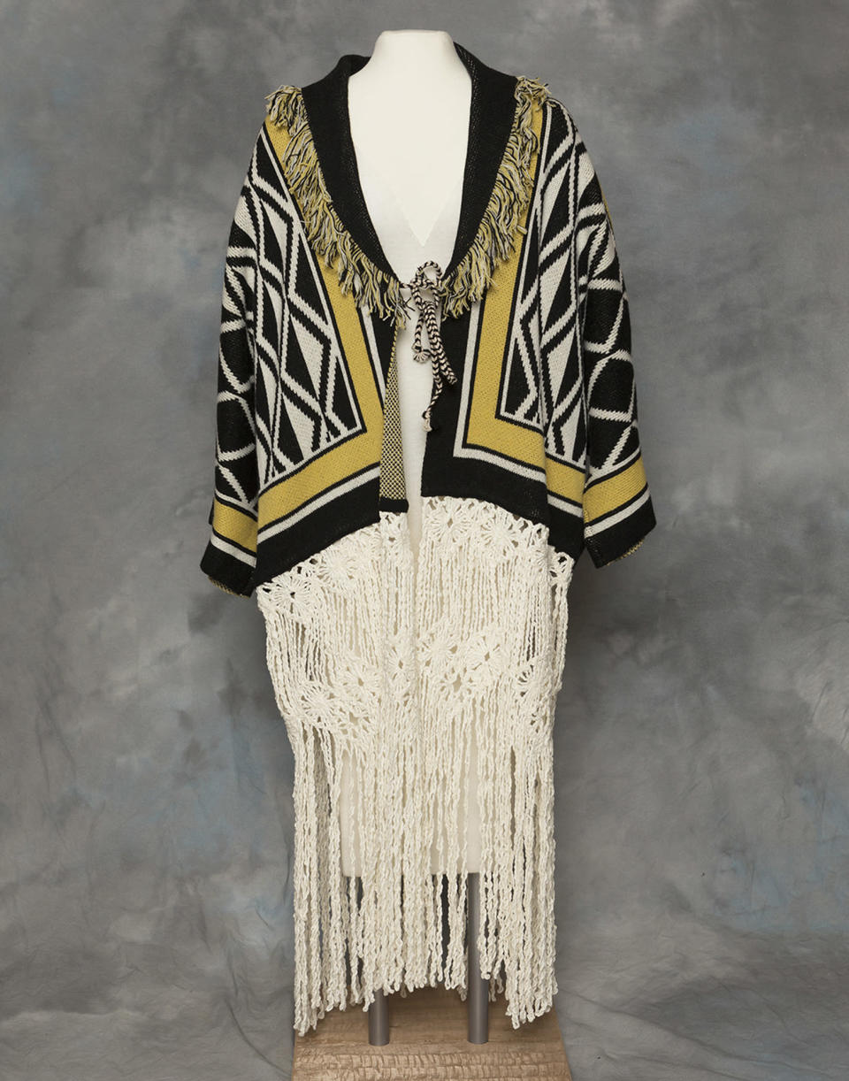 "In this undated photo provided by the Sealaska Hertiage Institute in Juneau, Alaska, shows the front of a Tlingit Ravenstail coat. An Alaska Native cultural organization and the luxury department store Neiman Marcus have settled a lawsuit over the sale of a coat with a copyrighted, geometric design borrowed from indigenous culture. The Sealaska Heritage Institute said in a statement on Wednesday, March 3, 2021, that it has agreed to work with Neiman Marcus and 11 other defendants to resolve the issue ""under Tlingit law and cultural protocols."" (Brian Wallace/Sealaska Heritage Institute via AP)"