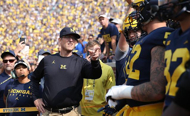 "ANN ARBOR, MI – SEPTEMBER 16: <a class=""link rapid-noclick-resp"" href=""/ncaab/teams/max/"" data-ylk=""slk:Michigan Wolverines"">Michigan Wolverines</a> head football coach Jim Harbaugh leads his team onto the field prior to the start of the game against the <a class=""link rapid-noclick-resp"" href=""/ncaab/teams/aab/"" data-ylk=""slk:Air Force Falcons"">Air Force Falcons</a> at Michigan Stadium on September 16, 2017 in Ann Arbor, Michigan.(Photo by Leon Halip/Getty Images)"