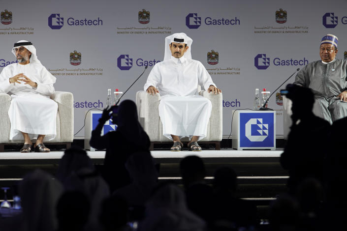 From left, Emirati Energy and Infrastructure Minister Suhail al-Mazrouei, Qatar's Minister of State for Energy Affairs Saad Sherida al-Kaabi and OPEC Secretary-General Mohammad Sanusi Barkindo sit on stage during the Gastech 2021 conference in Dubai, United Arab Emirates, Tuesday, Sept. 21, 2021. Energy officials from Qatar and Turkey, long-standing foes of the United Arab Emirates, descended on Dubai along with hundreds of other executives on Tuesday, flocking to the largest gas expo in the world and the industry's first in-person conference since the pandemic began. (AP Photo/Jon Gambrell)