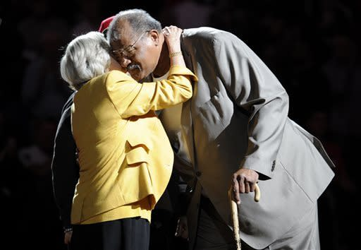 Former Washington Bullets basketball player and Hall of Famer Wes Unseld, right, is greeted by Irene Pollin, left, wife of the late Bullets' owner Abe Pollin, during a ceremony to celebrate the 35th anniversary of the Bullets only NBA championship, during halftime of an NBA basketball game between the Washington Wizards and the Indiana Pacers, Saturday, April 6, 2013, in Washington. The Bullets later changed their name to the Wizards. (AP Photo/Nick Wass)