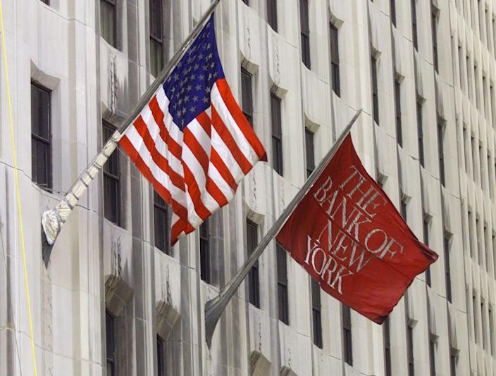 A Bank of New York flag flies next to the American flag at the Bank of New York headquarters in New York on August 19, 1999. (Photo: Peter Morgan/REUTERS)