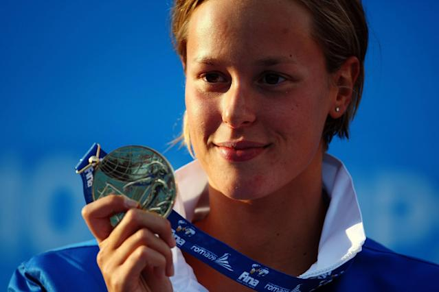 ROME - JULY 29: Federica Pellegrini of Italy receives the gold medal during the medal ceremony for the Women's 200m Freestyle Final during the 13th FINA World Championships at the Stadio del Nuoto on July 29, 2009 in Rome, Italy. (Photo by Lars Baron/Bongarts/Getty Images)