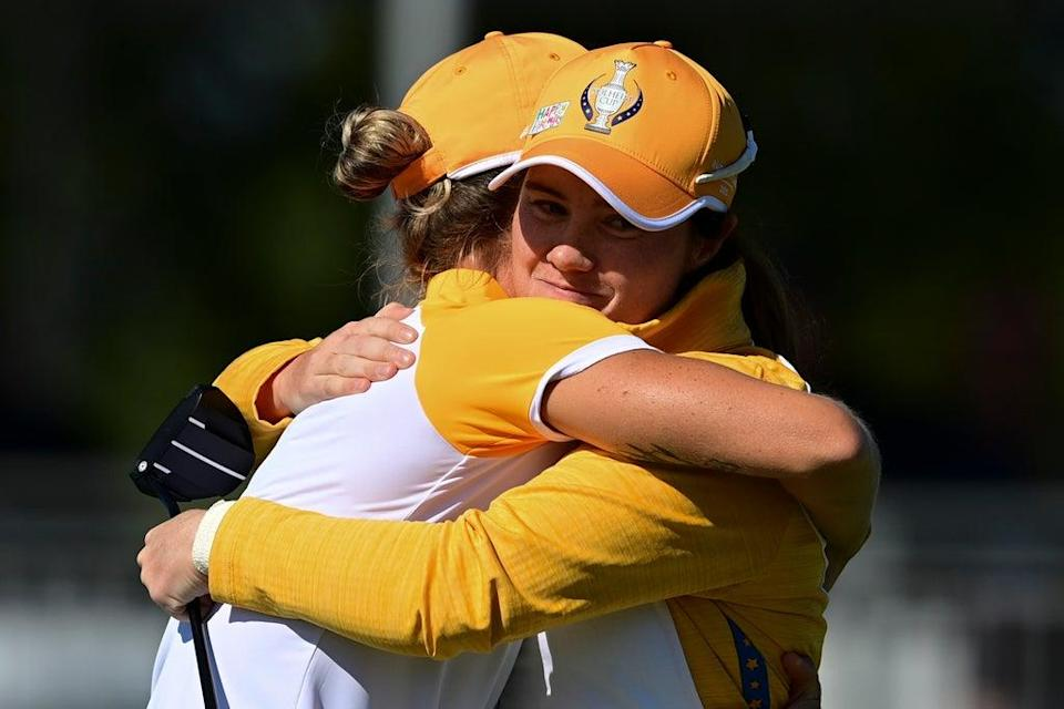 Leona Maguire (right) and Mel Reid celebrate their win against the USA in Sunday's foursomes in the 17th Solheim Cup (David Dermer/AP) (AP)