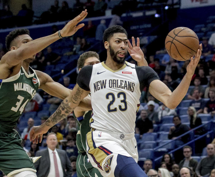 FILE - In this Tuesday, March 12, 2019 file photo, New Orleans Pelicans forward Anthony Davis (23) takes an outlet pass against Milwaukee Bucks forward Giannis Antetokounmpo (34) in the first half of an NBA basketball game in New Orleans. Pelicans basketball operations chief David Griffin says the timing of next week's NBA draft won't necessarily raise urgency to trade disgruntled six-time All-Star Anthony Davis. The Pelicans have the first overall pick in the June 20 NBA draft and likely could acquire more high picks by dealing Davis by then.(AP Photo/Scott Threlkeld, File)
