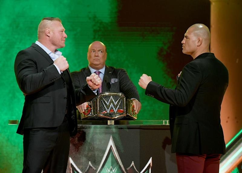 LAS VEGAS, NEVADA - OCTOBER 11: WWE champion Brock Lesnar (L) and former UFC heavyweight champion Cain Velasquez (R) face off as Lesnar's advocate Paul Heyman (C) looks on during the announcement of their match at a WWE news conference at T-Mobile Arena on October 11, 2019 in Las Vegas, Nevada. Lesnar will face Velasquez and WWE wrestler Braun Strowman will take on heavyweight boxer Tyson Fury at the WWE's Crown Jewel event at Fahd International Stadium in Riyadh, Saudi Arabia on October 31. (Photo by Ethan Miller/Getty Images)