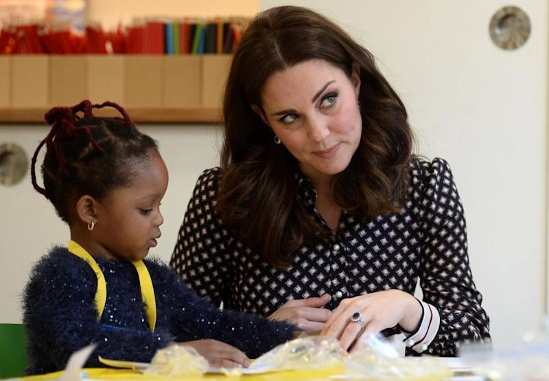 Kate met kids at a London museum on Tuesday and commented on Meghan and Harry's engagement. Photo: Getty
