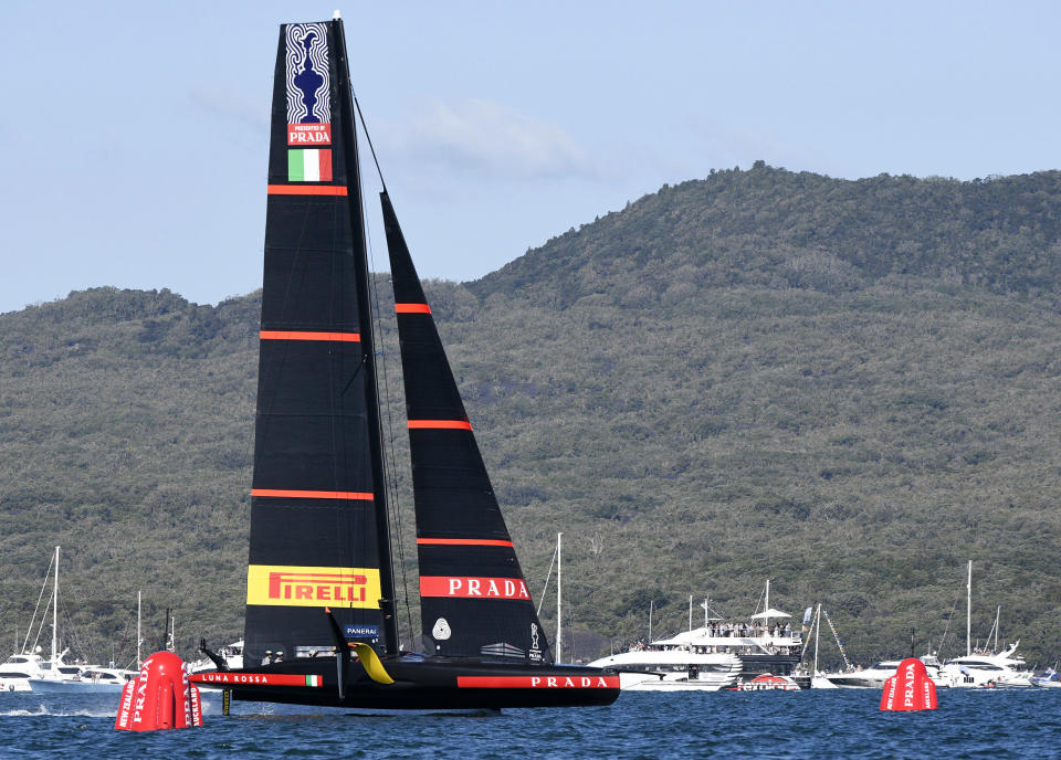 Italy's Luna Rossa crosses the finish line to defeat Team New Zealand in race 5 of the America's Cup on Auckland's Waitemata Harbour, New Zealand, Saturday, March 13, 2021. (Chris Cameron/Photosport via AP)