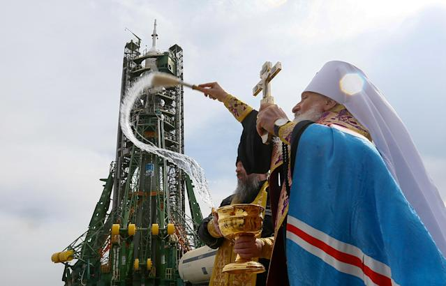 An Orthodox priest conducts a blessing in front of the Soyuz MS-08 spacecraft set on the launchpad ahead of its upcoming launch with International Space Station (ISS) crew, at the Baikonur Cosmodrome in Kazakhstan March 20, 2018. REUTERS/Shamil Zhumatov TPX IMAGES OF THE DAY