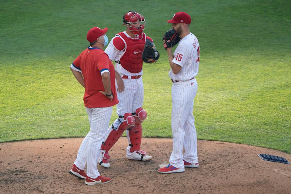 Price, then the Phillies' pitching coach, speaks to Zack Wheeler during a mound visit in 2020.