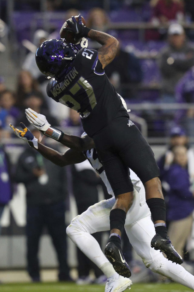 TCU safety Ar'Darius Washington (27) intercepts a pass intended for West Virginia wide receiver Sam James (13) in the second quarter of an an NCAA college football game Friday, Nov. 29, 2019, in Fort Worth, Texas. (AP Photo/Richard W. Rodriguez)