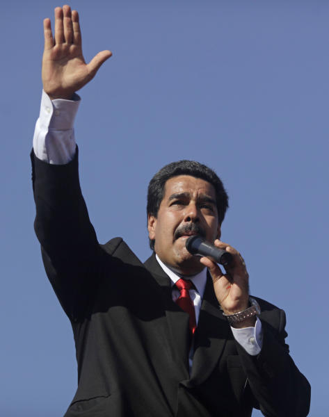 Venezuela's Vice President Nicolas Maduro speaks to people outside the military academy where the body of Venezuela's late President Hugo Chavez lies in state in Caracas, Venezuela, Thursday, March 7, 2013. Maduro, Venezuela's acting president, said Chavez's remains will be put on permanent display at the Museum of the Revolution, close to the presidential palace where Chavez ruled for 14 years. A state funeral for Chavez attended by some 33 heads of government is scheduled to begin Friday morning. Chavez died on March 5 after a nearly two-year bout with cancer. He was 58. (AP Photo/Rodrigo Abd)