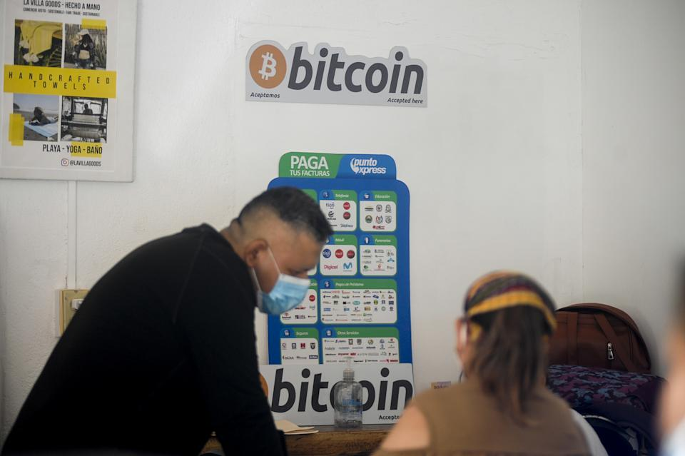 LA LIBERTAD, EL SALVADOR - JUNE 16: Salvadorans perform a bitcoin transaction on June 16, 2021 in Chiltuipan, El Salvador. Playa El Zonte has been named as the Bitcoins capital, around 500 families promote the use of the cryptocurrency to help the economy of a place with poverty issues. Salvadorans from the El Zonte community have been using Bitcoin for two years in their businesses, purchases, and basic basket payments. El Salvador became the first country in the world in recognizing bitcoin as legal tender. (Photo by Alex Pena/Anadolu Agency via Getty Images)