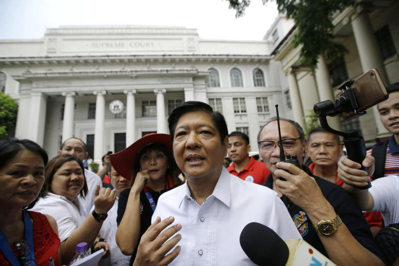 """Former Senator Ferdinand """"Bongbong"""" Marcos Jr. talks to reporters in front of the Philippine Supreme Court in Manila, Philippines, Monday, April 2, 2018. (AP Photo/Aaron Favila)"""
