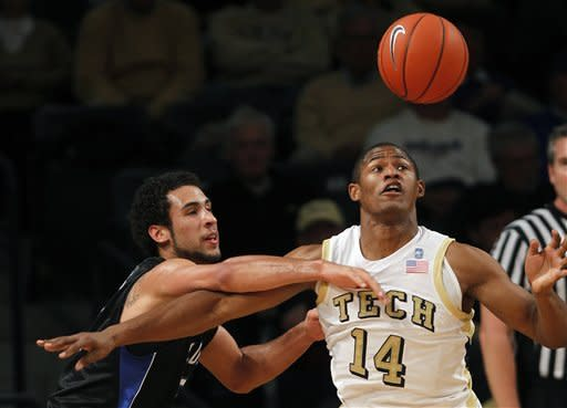 Presbyterian guard Jordan Downing, left, and Georgia Tech guard/forward Jason Morris (14) battle for a loose ball in the first half of an NCAA college basketball game on Wednesday, Nov. 14, 2012, in Atlanta. (AP Photo/John Bazemore)