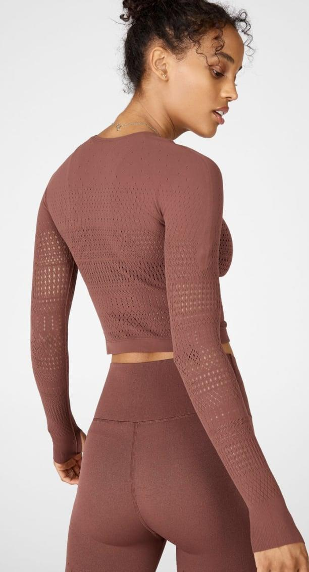 <p>The small cut-outs in the <span>Fabletics Briella Macrame Sculptknit Long-Sleeve</span> ($49) make this piece a breathable option in spite of the long sleeves. </p>