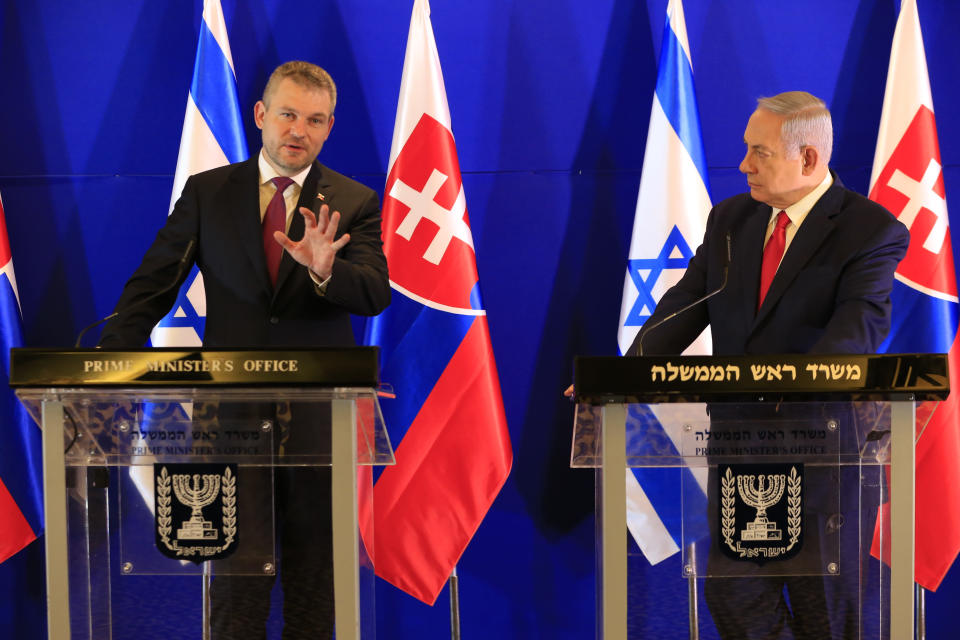 Slovakia's Prime Minister Peter Pellegrini, left, speaks as Israeli Prime Minister Benjamin Netanyahu listens after their meeting in Jerusalem, Tuesday, Feb. 19, 2019. (AP Photo/Ariel Schalit, Pool)