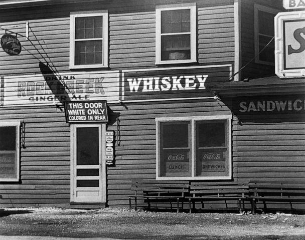 PHOTO: A restaurant in Maryland has a sign over its front entrance designating it 'white only' and telling African Americans that they must enter the establishment through the rear door, circa. 1948. (Joe Schwartz Photo Archive/Corbis via Getty Images, FILE)