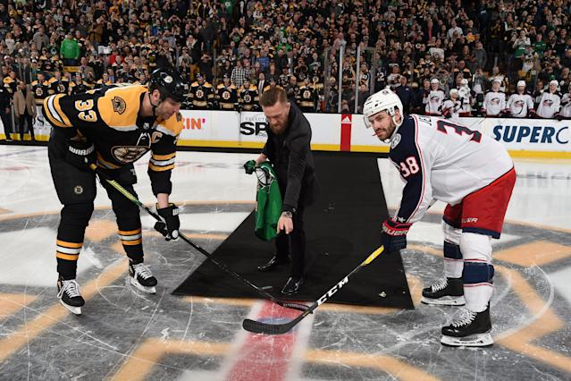 Conor McGregor drops the puck before Bruins game. (Photo by Steve Babineau/NHLI via Getty Images)