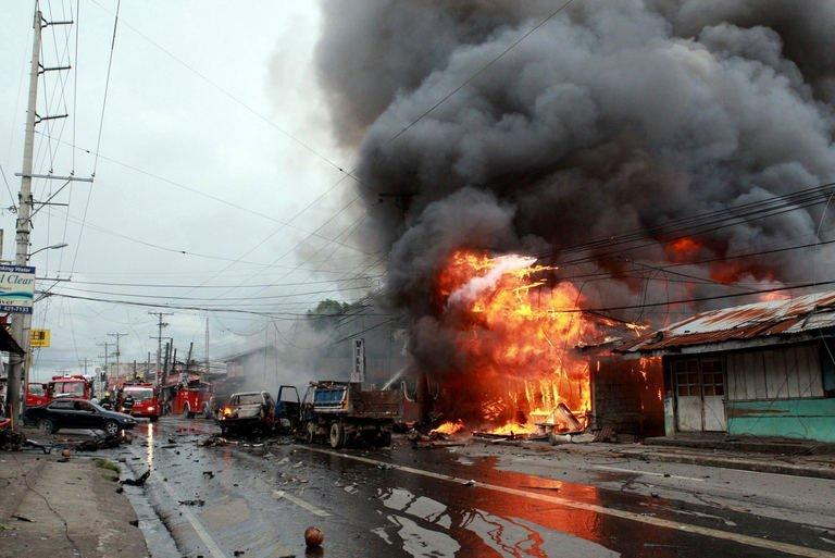 A building on fire after a bomb explosion in Cotabato city, on the southern Philippines island of Mindanao on August 5, 2013. The powerful bomb which was heard for kilometres around killed six people Monday in a city where the United States and other governments earlier warned of a terror threat