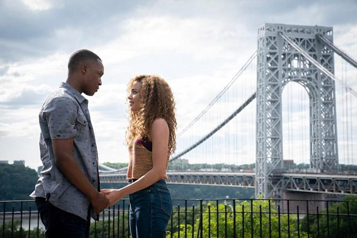 Corey Hawkins and Leslie Grace are shown in In The Heights. (Credit: Warner Bros. Ent)