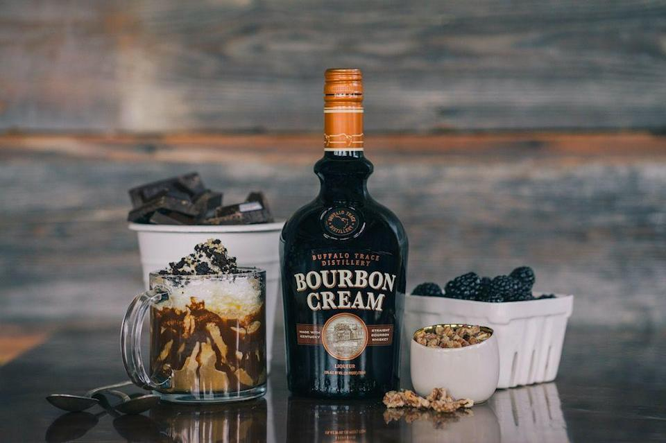 """<p>Combine 50ml <a href=""""https://www.amazon.co.uk/Buffalo-Trace-Bourbon-Cream-Liqueurs/dp/B019FN2136?tag=hearstuk-yahoo-21&ascsubtag=%5Bartid%7C1919.g.34687711%5Bsrc%7Cyahoo-uk"""" rel=""""nofollow noopener"""" target=""""_blank"""" data-ylk=""""slk:Buffalo Trace Distillery Bourbon Cream,"""" class=""""link rapid-noclick-resp"""">Buffalo Trace Distillery Bourbon Cream, </a>100ml root beer and 1 scoop vanilla ice-cream in glass, and top with whipped cream and chocolate syrup. </p>"""