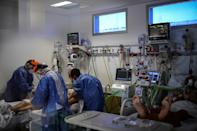 Health workers tend to a Covid-19 patient in the ICU at a hospital in Florencio Varela, Argentina in April 2021