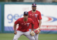 Minnesota Twins shortstop Jorge Polanco, left, and second baseman Luis Arraez are shown during spring training baseball practice on Wednesday, Feb. 24, 2021, in Fort Myers, Fla. (AP Photo/Brynn Anderson)