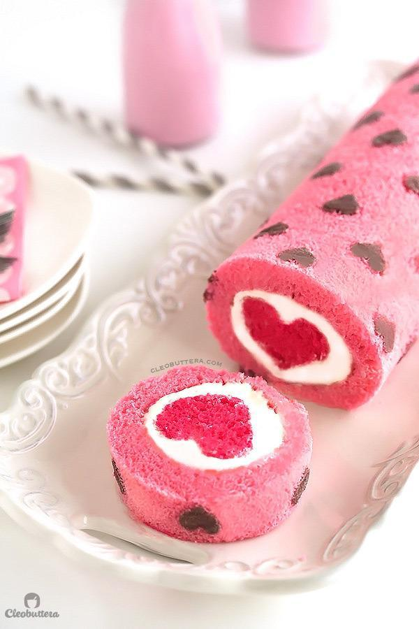 """<p>Oh we do love a surprise cake. <i>[Photo:<a href=""""http://cleobuttera.com/cakes/love-is-all-around-cake-roll/"""" rel=""""nofollow noopener"""" target=""""_blank"""" data-ylk=""""slk:Cleo Buttera"""" class=""""link rapid-noclick-resp""""> Cleo Buttera</a>]</i></p>"""