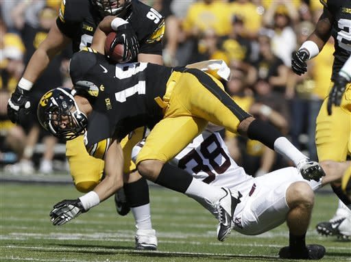 Iowa's Micah Hyde is tackled by Minnesota's David Schwerman (38) during a punt return in the first half of an NCAA college football game, Saturday, Sept. 29, 2012, in Iowa City, Iowa. (AP Photo/Charlie Neibergall)