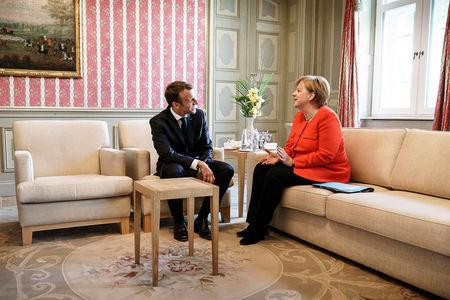 German Chancellor Merkel and French President Macron attend a bilateral meeting at the German government guesthouse Meseberg Palace in Meseberg
