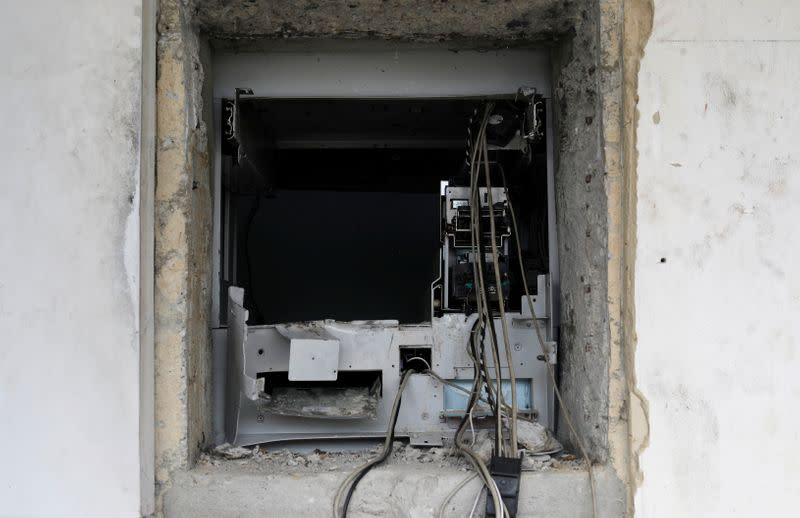 A destroyed ATM cash machine is pictured in the Lekki district of the commercial capital Lagos