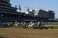 Medina Spirit, right, with John Velazquez aboard, leads the field around the first turn on the way to winning the 147th running of the Kentucky Derby at Churchill Downs, Saturday, May 1, 2021, in Louisville, Ky. (AP Photo/Michael Conroy)