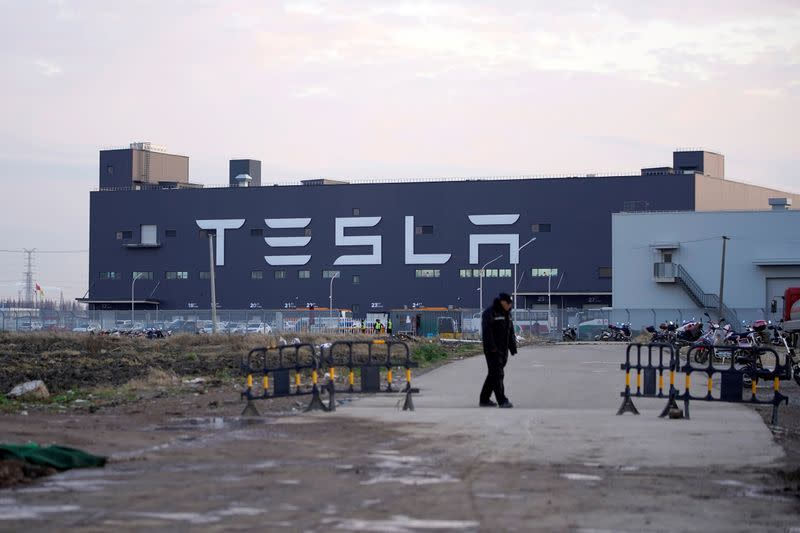 FILE PHOTO: A Tesla sign is seen on the Shanghai Gigafactory of the U.S. electric car maker before a delivery ceremony in Shanghai