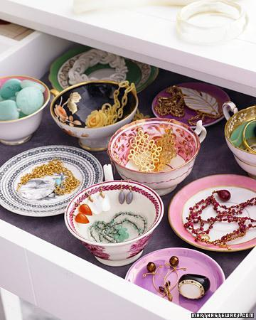 """<div class=""""caption-credit""""> Photo by: Martha Stewart Living</div><b>Stylish Jewelry Storage</b> <br> Orphaned teacups and saucers are perfect vessels for sorting jewelry, and, when arranged in a velvet-lined drawer, they give you an easy-to-scan bird's-eye view of your bijoux. To set it up, measure the height of the drawer's side (not the front), then gather dishware that's slightly shorter. Line the drawer with velvet or felt to prevent rattling and sliding, then position the porcelain. Hook drop earrings on rims of cups, nestle necklaces within them, and stash chunkier beads and bangles on individual saucers. <br> <b>Related:</b> <br> <b><a href=""""http://www.marthastewart.com/275539/bedroom-decorating-ideas/@center/277006/bedroom-and-bathroom-decorating?xsc=synd_yshine"""" rel=""""nofollow noopener"""" target=""""_blank"""" data-ylk=""""slk:23 Ways to Decorate Your Bedroom"""" class=""""link rapid-noclick-resp"""">23 Ways to Decorate Your Bedroom</a> <br> <a href=""""http://www.marthastewart.com/275280/bathroom-organization-tips/@center/277006/bedroom-and-bathroom-decorating?xsc=synd_yshine"""" rel=""""nofollow noopener"""" target=""""_blank"""" data-ylk=""""slk:24 Ways to Organize Your Bathroom"""" class=""""link rapid-noclick-resp"""">24 Ways to Organize Your Bathroom</a></b> <br>"""