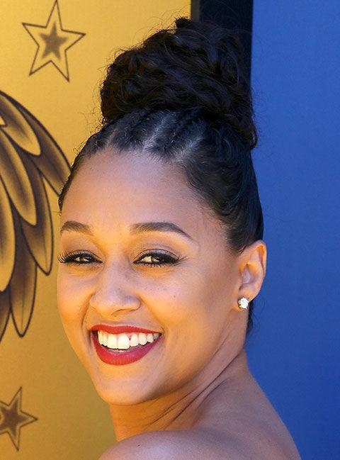 <p>With triple cornrows scooped and wrapped into a braided knot, Mowry's bun feels anything but boring. <span></span></p>