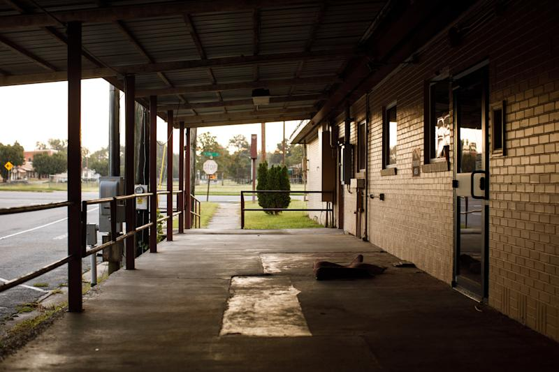 A crumpled rug sits outside the closed Lower Oconee Community Hospital in Glenwood. (Dustin Chambers for HuffPost)