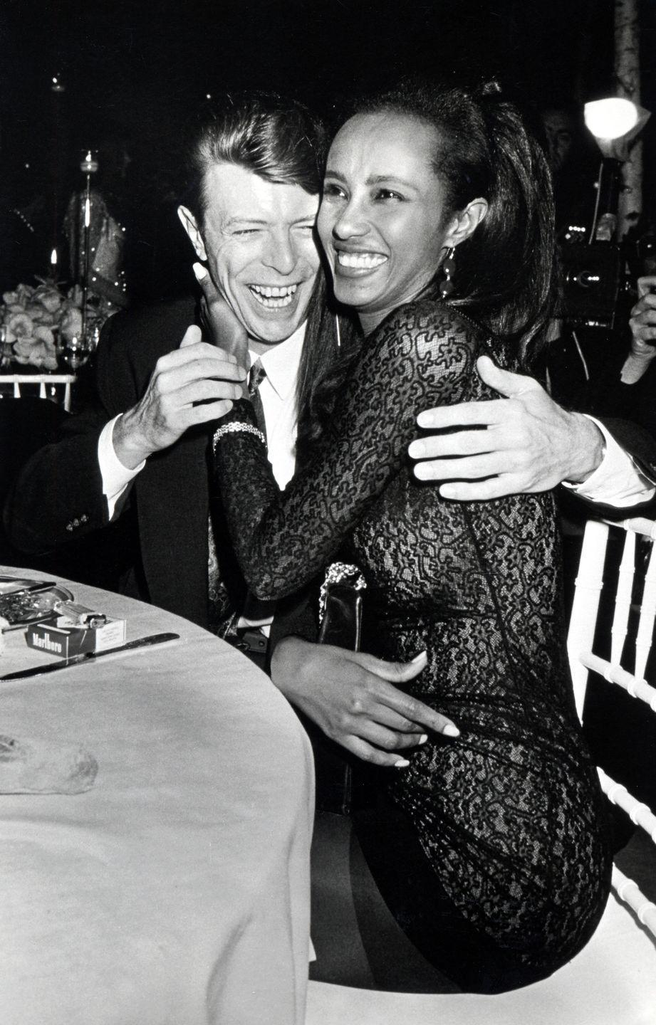 <p>Bowie and Iman were captured sharing a moment of affection at a 1990 event to benefit AIDS Research.</p>