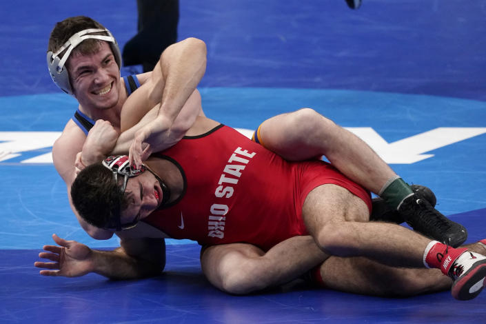 Pittsburgh's Jake Wentzel, top, takes on Ohio State's Ethan Smith during their 165-pound match in the semifinal round of the NCAA wrestling championships Friday, March 19, 2021, in St. Louis. (AP Photo/Jeff Roberson)