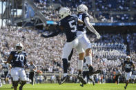 Penn State wide receiver Jahan Dotson (5) celebrates his first quarter touchdown pass with Theo Johnson (84) against Villanova during an NCAA college football game in State College, Pa., on Saturday, Sept.25, 2021. (AP Photo/Barry Reeger)