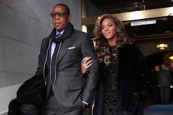 Jay-Z and Beyonce arrive at the presidential inauguration on the West Front of the U.S. Capitol January 21, 2013 in Washington, DC. Barack Obama was re-elected for a second term as President of the United States. (Photo by Win McNamee/Getty Images)