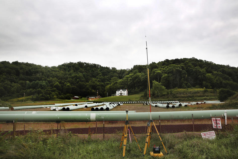 FILE - In this Sept 15, 2020 file photo sections of pipe for the Mountain Valley Pipeline are seen lined up Elliston, Va. Environmentalists have filed a new legal challenge against a U.S. government program that allows oil and gas pipelines to be built across wetlands, rivers and other bodies of water. The lawsuit filed Monday, May 3, 2021, in U.S. District Court alleges the program lets companies skirt environmental reviews of potential spills. (Heather Rousseau/The Roanoke Times via AP,File)