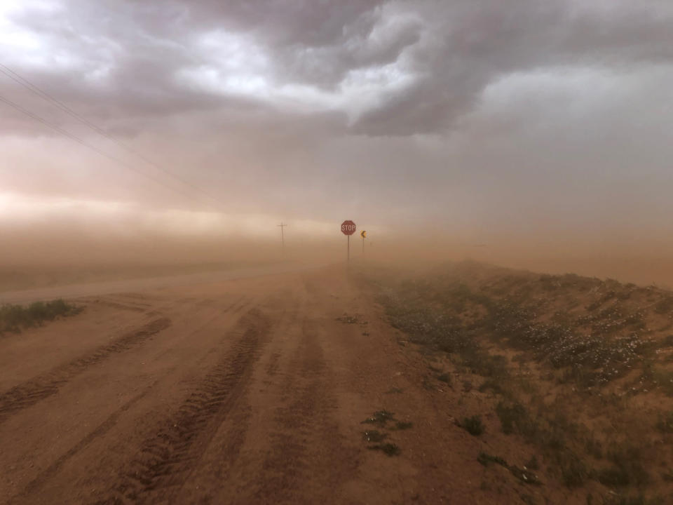 """In this photo provided by Jude Smith, sand blowing off fields creates a dust storm near Morton, Texas, on May 18, 2021. The U.S. Department of Agriculture is encouraging farmers in a """"Dust Bowl zone"""" that includes parts of Texas, New Mexico, Oklahoma, Kansas and Colorado, to preserve and establish grasslands as the area becomes increasingly dry. (Jude Smith via AP)"""