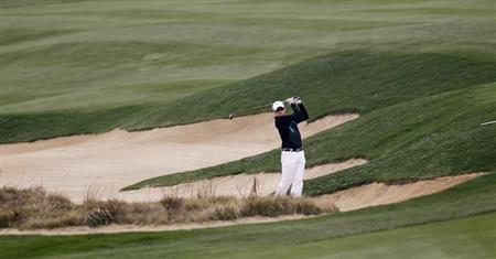 Simon Dyson of Britain hits out of a sand trap on the seventh hole during the BMW Masters 2013 golf tournament at Lake Malaren Golf Club in Shanghai, October 25, 2013. REUTERS/Carlos Barria