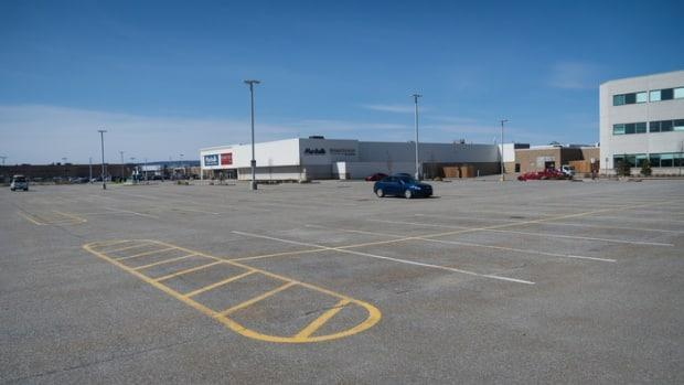 The nearly empty parking lot at the Les Promenades Gatineau shopping mall is seen on April 3, 2021.