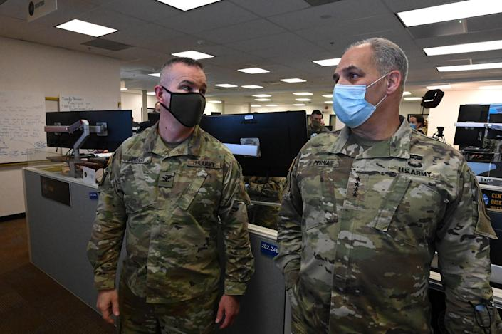 "Operation Warp Speed information technology lead Colonel R.J. Mikesh speaks with General Gus Perna in the Vaccine Operations Center.<span class=""copyright"">Department of Defense</span>"