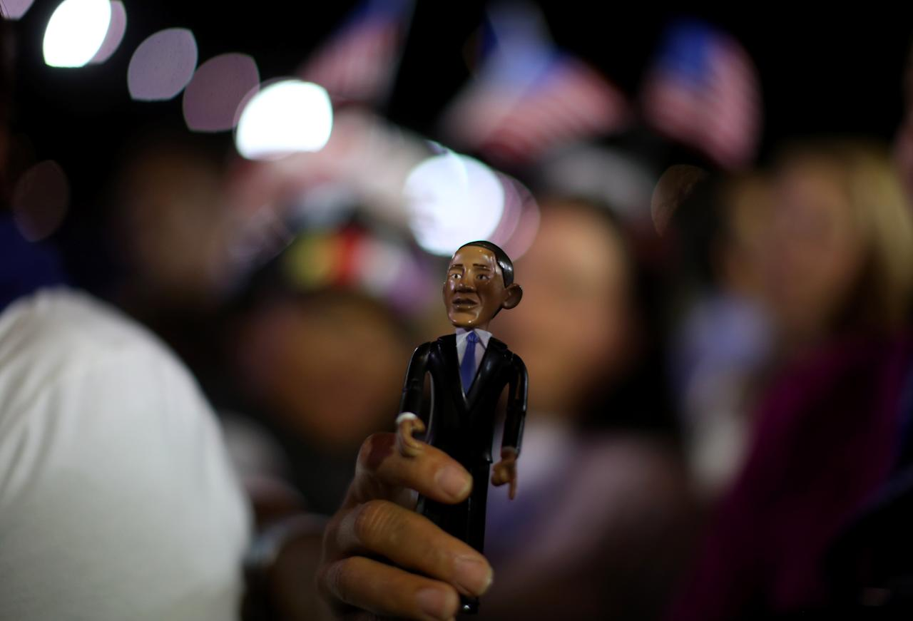 CHICAGO, IL - NOVEMBER 06:  A supporter of U.S. President Barack Obama holds up a doll in his likeness during the Obama Election Night watch party at McCormick Place November 6, 2012 in Chicago, Illinois. Obama is going for reelection against Republican candidate, former Massachusetts Governor Mitt Romney.  (Photo by Chip Somodevilla/Getty Images)