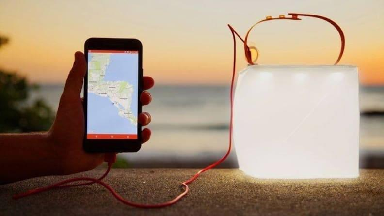 Charge up this lantern in the sun, then use it to charge your phone.
