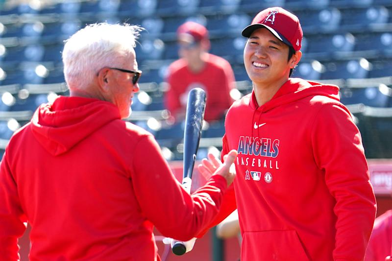 TEMPE, AZ - FEBRUARY 29: Manager Joe Maddon and Shohei Ohtani of the Los Angeles Angels talk during a Los Angeles Angels spring training on February 29, 2020 in Tempe, Arizona. (Photo by Masterpress/Getty Images)