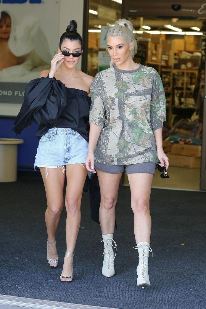 """<p><strong>When: Oct. 9, 2017 </strong><br>Earlier that day, Kim and Kourtney <a rel=""""nofollow"""" href=""""https://ca.style.yahoo.com/kim-kourtney-kardashian-baby-shopping-151500831.html"""" data-ylk=""""slk:were spotted shopping at Buy Buy Baby in Calabasis, Calif.;outcm:mb_qualified_link;_E:mb_qualified_link;ct:story;"""" class=""""link rapid-noclick-resp yahoo-link"""">were spotted shopping at Buy Buy Baby in Calabasis, Calif.</a>, wearing super short shorts. Kim pulled her hair into a high ponytail and paired her grey shorts with a print top and white lace-up booties. Meanwhile, sister Kourtney paired denim cutoffs with a black Milly off-the-shoulder blouse, oversized glasses, her signature topknot, and clear """"Kourt"""" heels. </p>"""