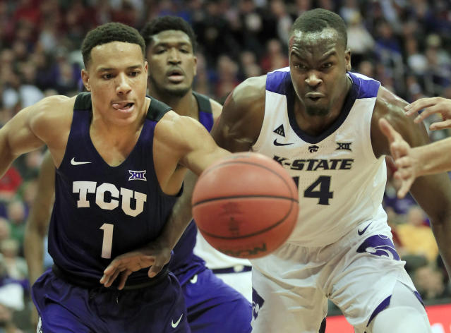 TCU guard Desmond Bane (1) and Kansas State forward Makol Mawien (14) chase a loose ball during the first half of an NCAA college basketball game in the quarterfinals of the Big 12 conference tournament in Kansas City, Mo., Thursday, March 14, 2019. (AP Photo/Orlin Wagner)